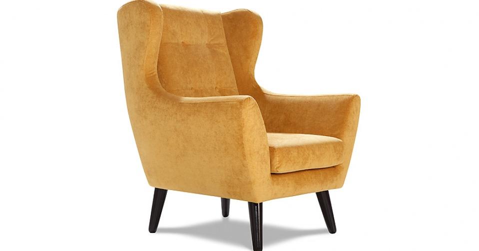 CLEO ozdobne pikowanie oparcia fotela podkreśla skandynawski styl kolekcji.