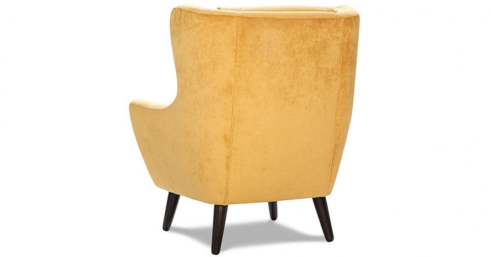 CLEO fotel na wysokich dębowych nogach.