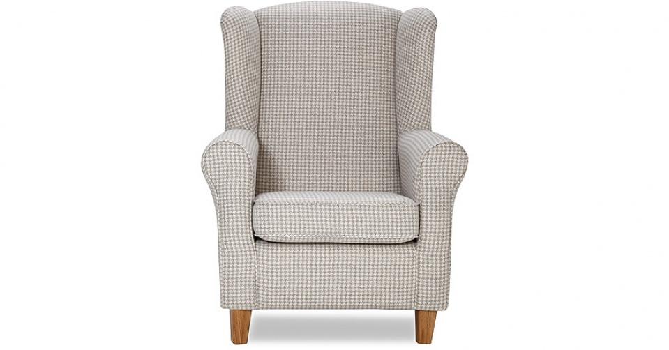 Fotel w jasnej tkaninie prezentuje się równie dobrze.